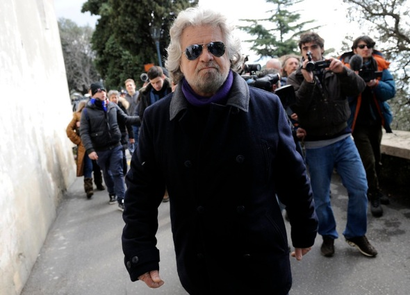 Five Star Movement leader and comedian Beppe Grillo leaves after casting his vote at the polling station in Genoa
